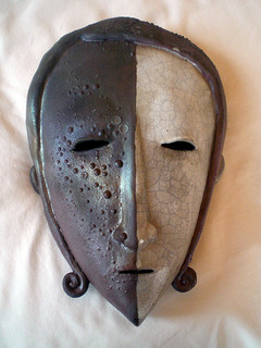Dark and Light, One Whole. Image: Yin-Yang mask by Chris Palmer