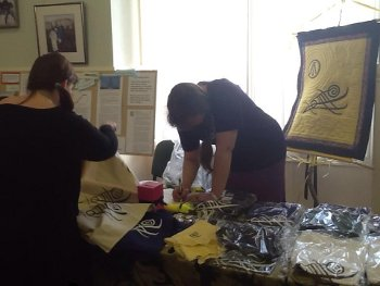 The Warrior's Call stall at OBOD 50th Anniversary, with information and merchandise. Spreading the magic of connection.